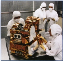 The two CERES instruments, being worked on in a cleanroom at TRW.