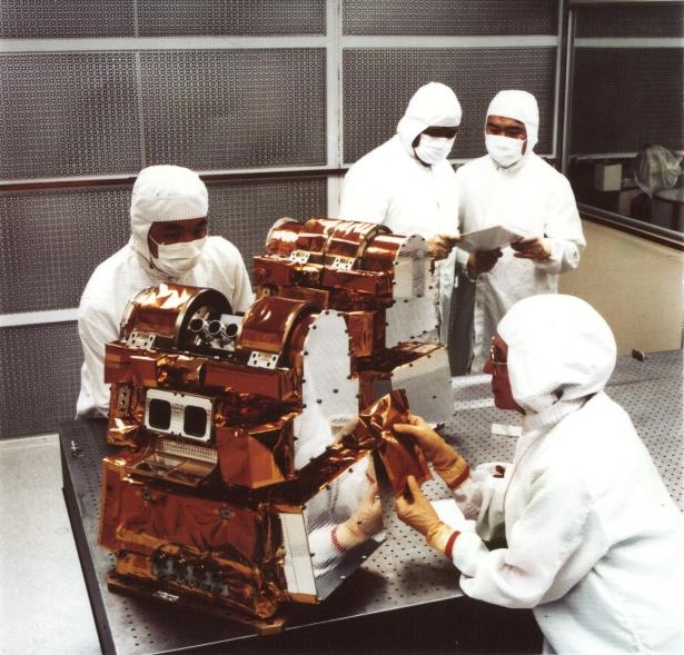 Installation of flight multi-layer insulation on CERES Flight Models 1 and 2 at the TRW clean room facility after completion of calibration in preparation for shipment to Vandenberg for integration on Terra.